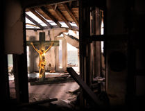 Religious Expression. Jesus crucifix in disaster broken home, religious expression to have faith when in a disaster Royalty Free Stock Photography