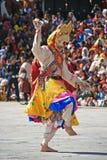 Religious festival - Thimphu - Bhutan. A man wearing a mask of devil is dancing in the courtyard of the Dzong of Thimphu (Bhutan). Un homme portant un masque de stock photo