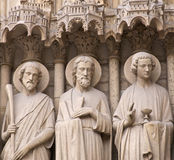 Religious Figures. Cared Religious Figures on the exterior wall of Notre Dame, Paris stock photography