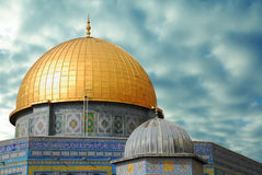 Religious forces. Golden dome of the sky against the backdrop of the terrible Stock Photo