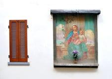 Religious fresco wall decoration. Religious fresco on Italian house wall Stock Photo