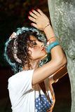 Religious girl praying outdoor at night time. Next to a tree Royalty Free Stock Photography