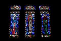 Religious glass art. Three windows from historic church on military base Stock Photos