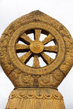Religious gold symbol on top of a temple Stock Photo