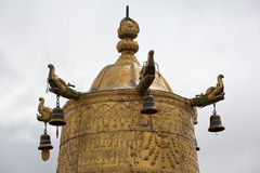 Religious gold symbol on top of a temple Royalty Free Stock Photos
