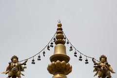 Religious gold symbol on top of a temple Royalty Free Stock Photo
