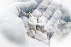 Religious Golden Cross In Palm Of Hand With Beautiful Clouds In Background High Quality