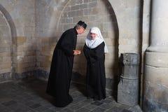 Religious gossip Stock Photos