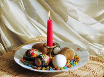 Religious holiday Easter. On a table there is a plate with Easter eggs Royalty Free Stock Photos