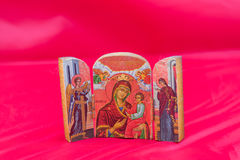 Religious icon. Beautiful religious icon on a red background Royalty Free Stock Photography