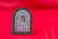 Religious icon. Beautiful religious icon on a red background Stock Photos