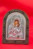Religious icon. Beautiful religious icon on a red background Royalty Free Stock Photo