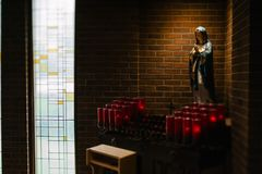Religious Icon Near Candles in Lighted Room Stock Images