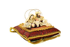 Religious icons on cushion. Christian religious figures of Mary, Joseph and Jesus on red cushion, white background Stock Photography