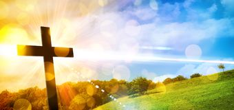 Religious representation with cross and nature landscape background stock photos