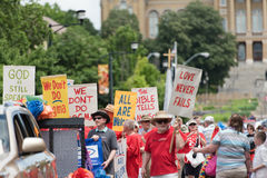 Religious inclusion for Gays in Des Moines. A group holds signs against religious hatred in the gay pride parade 2015 - Des Moines, Iowa stock photos
