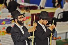 Religious Jews in black hats and piles. BNEI- BRAK, ISRAEL - SEPTEMBER 17, 2013: Traditional market before the holiday of Sukkot. Religious Jews in black hats Stock Photo