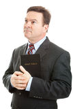 Religious Man. Religious Christian man in a business suit, holding his bible and looking heavenward. Isolated on white stock photos