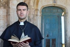 Religious man holding the Bible stock images