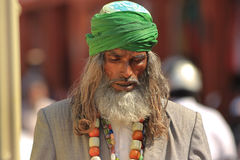 Religious man India. JAIPUR, INDIA, MARCH 4: An unidentified religious man performing prayers in the street outside the City Palace on March 4, 2012 ahead of the Stock Images