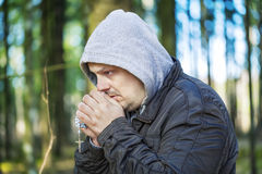 Religious man with a rosary. In forest Royalty Free Stock Photo