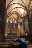 Religious mass at Notre-Dame-du-Bout-du-Pont Church, Saint-Jean-Pied-de-Port, France. SAINT-JEAN-PIED-DE-PORT, FRANCE - MAY 04, 2017: Evening service at Notre stock images