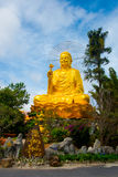 Religious monument, seated gold Buddha Stock Image