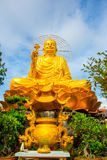 Religious monument, seated gold Buddha Royalty Free Stock Images