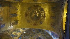 Religious mosaic painting on the dome of St. Marco Church intern. Al, Venice Italy stock images