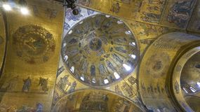 Religious mosaic painting on the dome of St. Marco Church intern. Al, Venice Italy stock image