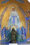 Religious mosaic and statue in Lourdes royalty free stock image