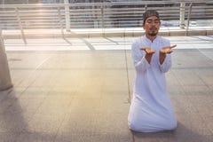 Religious muslim man praying in city Royalty Free Stock Image