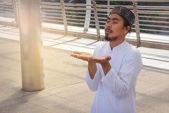 Religious muslim man praying in city Royalty Free Stock Photos