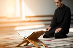 Religious muslim man praying inside the mosque Royalty Free Stock Photography