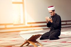 Religious muslim man praying inside the mosque Royalty Free Stock Photo