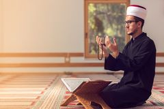 Religious muslim man praying inside the mosque Stock Images