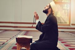 Religious muslim man praying inside the mosque Royalty Free Stock Image