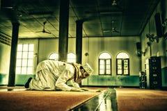 Religious muslim man praying inside mosque stock photography