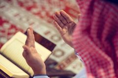 Religious muslim man praying inside the mosque Stock Photography