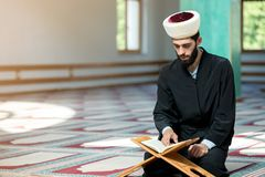 Religious muslim man praying inside the mosque Royalty Free Stock Images
