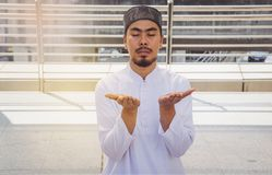 Religious muslim man praying stock images