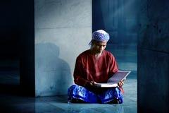 Religious muslim man reading holy koran Royalty Free Stock Image