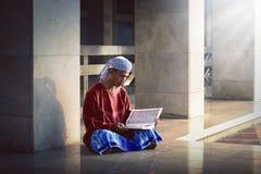 Religious muslim man reading holy koran Royalty Free Stock Photography