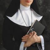 Religious nun in religion concept against dark background Stock Photos