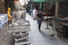 Religious objects shop. Religous sculpture displayed on the street in Bangkok in front of shop Royalty Free Stock Photo