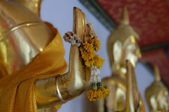 Religious offering on Buddha statue Stock Photography