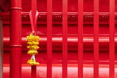 Religious offerings of marigold strings presented at temple. In rainy day stock photo