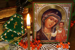 Religious orthodox still life with an icon of Holy Mother Stock Photos