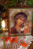 Religious orthodox still life with an icon of the Mother Mary Royalty Free Stock Photos