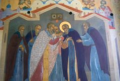 Religious painting on a church facade in Trinity Sergius Lavra in Russia. Color winter photo. Stock Photos